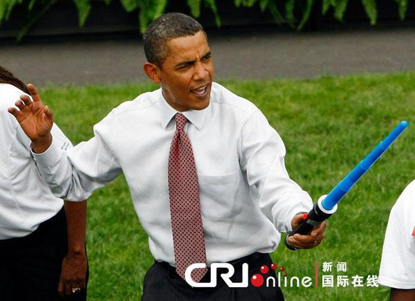 President Barack Obama jokingly attacks Olympic fencer Tim Morehouse during a fencing demonstration on the South Lawn of the White House promoting the city of Chicagos bid for the 2016 Summer Olympics September 16, 2009 in Washington, DC. Obama joined Chicago Mayor Richard Daley, members of the USOC, and representatives from the Chicago2016 group during the event.