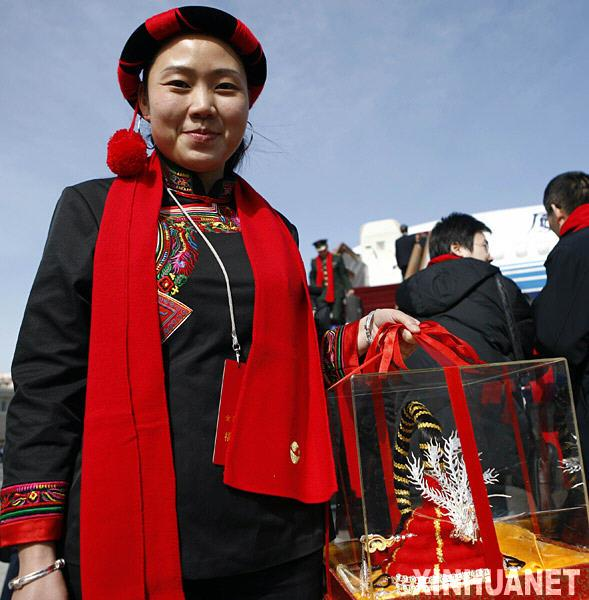 A deputy of She ethnic group to the Third Session of the 11th National People's Congress (NPC) attend the opening meeting of the session at the Great Hall of the People in Beijing, capital of China, March 5, 2010.