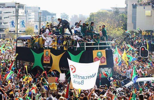 Around 60,000 football fans brought the streets of Johannesburg to a standstill to show their support for the South African World Cup team.