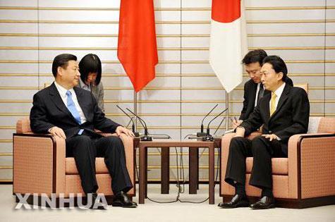 نائب الرئيس الصيني ورئيس الوزراء الياباني يناقشان العلاقات الثنائية