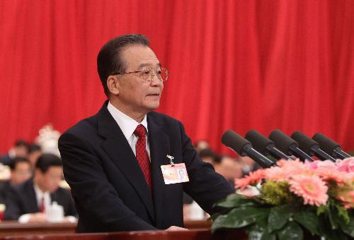 Chinese Premier Wen Jiabao delivers a government work report during the opening meeting of the Third Session of the 11th National People's Congress (NPC) at the Great Hall of the People in Beijing, capital of China, March 5, 2010. (Xinhua/Liu Weibing)