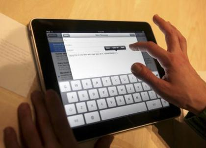 "Typing is demonstrated on the new Apple ""iPad"" during the launch of the tablet computing device in San Francisco, California, January 27, 2010. (Xinhua/Reuters Photo)"