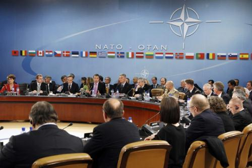 NATO Secretary-General Anders Fogh Rasmussen (4th L) gives a speech during the opening session of a NATO defence ministers meeting (NAC) at the Alliance headquarters in Brussels June 10, 2010. (Xinhua/Reuters Photo)