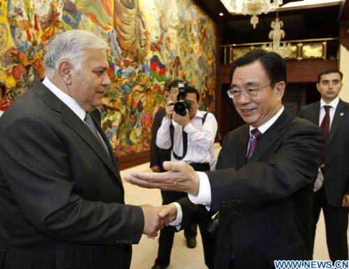 He Guoqiang (R), member of the Standing Committee of the Political Bureau of the Communist Party of China (CPC) Central Committee and secretary of the CPC's Central Commission for Discipline Inspection, shakes hands with Azerbaijani Parliament Speaker Oktay Asadov in Baku, capital of Azerbaijan, June 16, 2010.(Xinhua/Liu Jiancsheng)