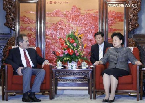 Chinese State Councilor Liu Yandong (R) meets with visiting Turkish Culture and Tourism Minister Ertugrul Gunay in Beijing, capital of China, on June 17, 2010.(Xinhua/Ding Lin)
