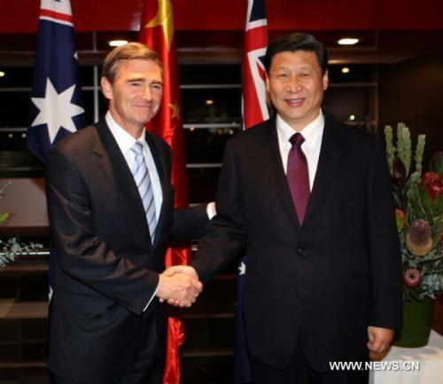 Chinese Vice President Xi Jinping (R) meets with Australia's Victorian Premier John Brumby in Melbourne, Australia, June 19, 2010. Xi arrived at Melbourne on Saturday afternoon, starting his official visit to Australia, the last leg of his four-nation visits.(Xinhua/Liu Weibing)
