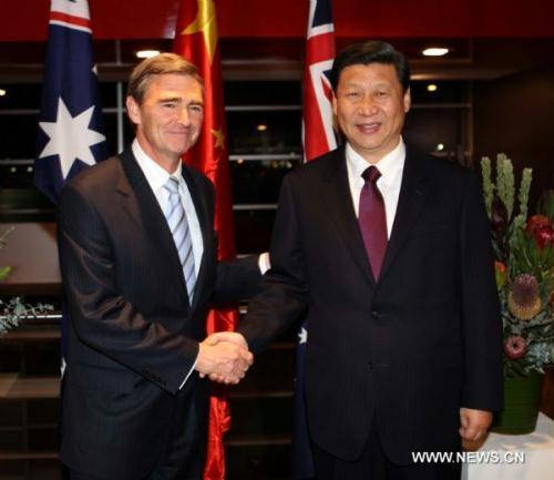 ChineseVicePresidentXiJinping(R)meetswithAustralia'sVictorianPremierJohnBrumbyinMelbourne,Australia,June19,2010.XiarrivedatMelbourneonSaturdayafternoon,startinghisofficialvisittoAustralia,thelastlegofhisfour-nationvisits.(Xinhua/LiuWeibing)