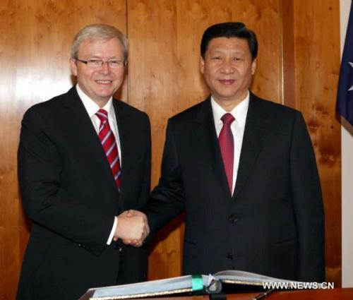 Visiting Chinese Vice President Xi Jinping (R) holds talks with Australian Prime Minister Kevin Rudd in Canberra, capital of Australia, June 21, 2010. (Xinhua/Liu Weibing)