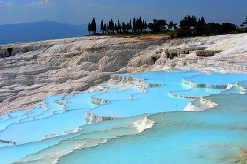 "Pamukkale, meaning ""cotton castle"" in Turkish, is a natural site in Denizli Province in south-western Turkey. The city contains hot springs and travertines, terraces of carbonate minerals left by the flowing water. (Photo Source: sina.com)"