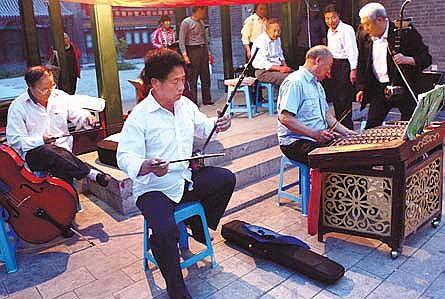 A band of elderly men playing music on the streets of Shanhaiguan.