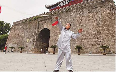 A kung fu master practicing his moves at the Shanhai Pass of Great Wall.