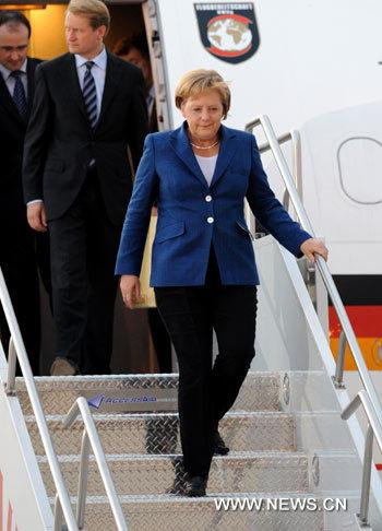 German Chancellor Angela Merkel arrives at the Pearson International airport in Toronto, Canada, on June 24, 2010. Angela Merkel arrived at Canada on Thursday to attend the upcoming G8 and G20 summits. (Xinhua Photo)
