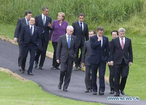 Canadian Prime Minister Stephen Harper (front R) is flanked by G-8 leaders as they stroll down a path on their way to pose for the leaders' group photo at the G-8 Summit in Huntsville, Ontario, on June 25, 2010. Clockwise on the rear row are: European Commission President Jose Manuel Barroso, Italian President Silvio Berlusconi, U.S. President Barack Obama, German Chancellor Anglea Merkel and French President Nicolas Sarkozy. Clockwise on the front row are European Council President Herman Van Rompuy, Russian President Dmitry Medvedev, British Prime Minister David Cameron, Japanese Prime Minister Naoto Kan and Canadian Prime Minister Stephen Harper. (Xinhua/Pool)
