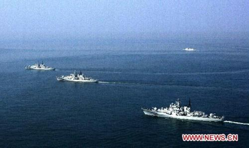 The undated photo shows Chinese People's Liberation Army (PLA) Navy's warships attend a routine live-ammunition training in the East China Sea. The training was held by the Navy's East China Sea Fleet recently.(Xinhua/Dai Zongfeng)