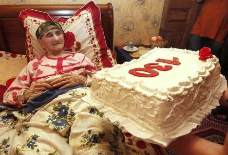 Birthday in bed: Antisa Khvichava rests during her 130th birthday party in the village of Sachino, Georgia. She claims to be the oldest person in the world