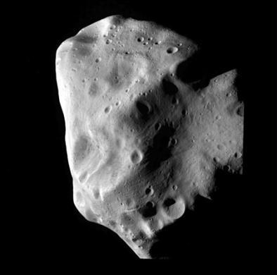 A picture shot by ESA's Rosetta mission's OSIRIS instrument shows asteroid Lutetia at a distance of 3162 km (1964 miles) its closest approach, July 10, 2010. The images show that Lutetia is heavily cratered, having suffered many impacts during its 4.5 billion years of existence. As Rosetta drew close, a giant bowl-shaped depression stretching across much of the asteroid rotated into view. The images confirm that Lutetia is an elongated body, with its longest side around 130km. (Xinhua/Reuters Photo)