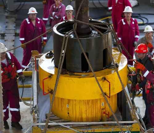 Workers onboard the Transocean Discoverer Inspiration retrieve the flange overshot tool used to remove the flange from the Deepwater Horizon BOP, July 11, 2010 in the Gulf of Mexico. (Xinhua/Reuters Photo)