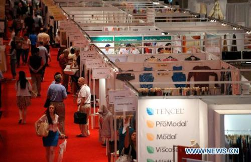 People visit the China Textile and Apparel Trade Show and the Home Textiles Fabric Sourcing Expo in New York, the United States, July 13, 2010. Some 400 enterprises from 15 countries showcased their products at the Expo, more than half of which are Chinese companies.(Xinhua/Shen Hong)