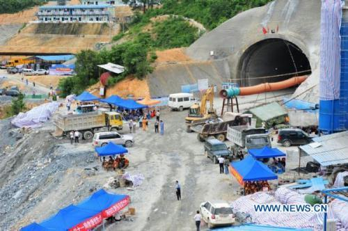 Photo taken on July 14, 2010 shows the portal of the collapsed tunnel in Binyang County of Nanning, capital southwest China's Guangxi Zhuang Autonomous Region. The tunnel collapsed again on Wednesday, which blocked the ongoing rescue work. Ten workers were trapped when the tunnel collapsed on Sunday.(Xinhua/Huang Xiaobang)