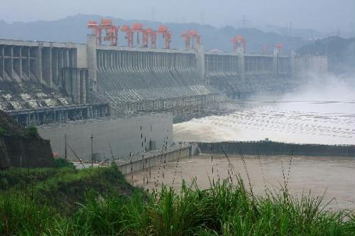 Flood waters are sluiced with the water outflux monitored at 40,000 cubic meters per second at Three Gorges Dam in Yichang, central China's Hubei Province, July 20, 2010. China's Three Gorges Dam project on the Yangtze River stood its biggest flood-control test at 8 a.m. Tuesday since completion, as the flow on the river's upper reaches topped 70,000 cubic meters a second. All ferry services were halted at the Three Gorges Dam on Monday, and would be resumed after the influx decreased to 45,000 cubic meters per second.(Xinhua/Xia Lin)
