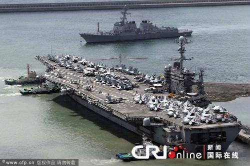 After departing from its base in  Yokosuka, Japan on July 9th, the 97- thousand ton US nuclear-powered aircraft  carrier USS George Washington arrived at  the port city of Busan in southern Korea  Wednesday morning.