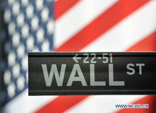 The Wall Street nameplate is pictured in New York, the United States, July 21, 2010. U.S. President Barack Obama on Wednesday signed into law the financial regulation reform bill, the most ambitious rewrite of the country's financial-regulatory system since the Great Depression. (Xinhua/Shen Hong)