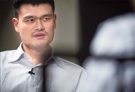 Basketball star Yao Ming in a contemplative mood during his interview with China Daily on Wednesday at the Crowne Plaza Beijing Parkview Wuzhou.(Photo: China Daily)