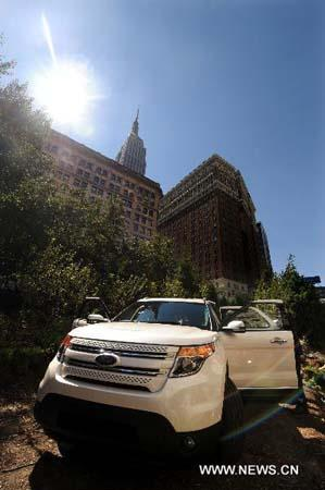 The new 2011 Ford Explorer is unveiled at a press event in New York, the United States, July 26, 2010. (Xinhua/Shen Hong)