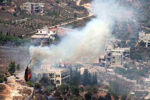 A fire is seen on the Lebanon side of the Israel-Lebanon border following the fire exchange that took place this afternoon between Israeli and Lebanese troops, Aug. 3, 2010. (Xinhua/Jini)