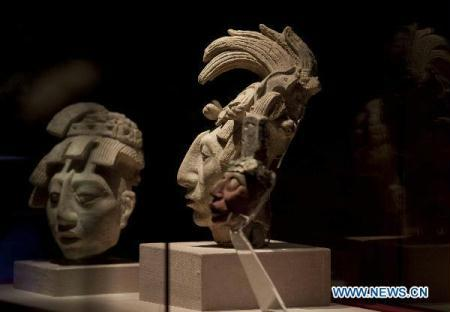 Maya masks are displayed at an exhibition at the Mexico National Museum of Anthropology, August 13, 2010. (Xinhua Photo)