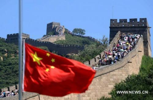 The national flag of China flies at half mast at the Badaling Great Wall in Beijing, capital of China, Aug. 15, 2010, to mourn for the victims of the Aug. 8 mudslide disaster in Zhouqu County, Gannan Tibetan Autonomous Prefecture in northwest China's Gansu Province. China on Sunday held mournings for the mudslide victims, all over the country and at overseas embassies and consulates.(Xinhua/Gong Lei)
