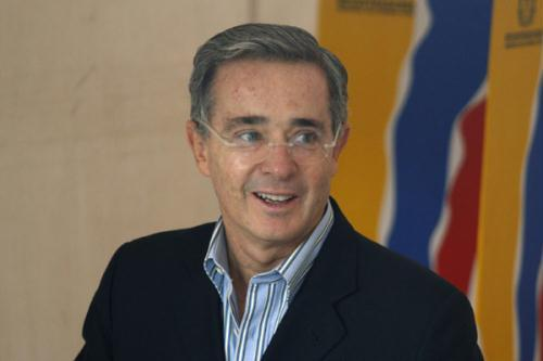 Colombia's President Alvaro Uribe smiles before casting his vote during legislative elections in Bogota March 14, 2010.  (Xinhua/Reuters File Photo)