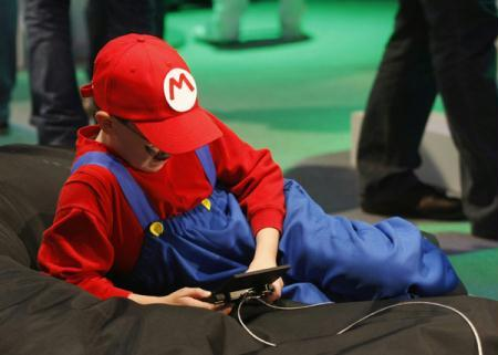 A boy dressed as ''Mario'' plays with a ''Nintendo DS'' at an exhibition stand during the Gamescom 2010 fair in Cologne August 19, 2010. The Gamescom convention, Europe's largest video games trade fair, runs from August 18 to August 22.(Xinhua/Reuters Photo)