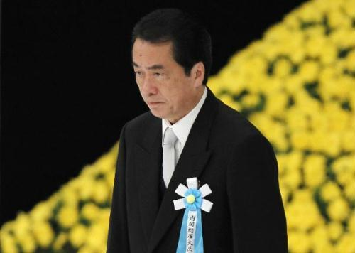Japan's Prime Minister Naoto Kan attends a memorial service for those who died in World War Two during a ceremony marking the 65th anniversary of Japan's surrender in the war at Budokan Hall in Tokyo August 15, 2010.(Xinhua/Reuters Photo)