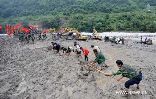 Rescuers clear off sludge in mudslide-hit Puladi Township of Gongshan Drung-Nu Autonomous County, southwest China's Yunnan Province, Aug. 20, 2010. (Xinhua/Lin Yiguang)