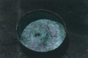 Excavated bronze bowl from the ruins