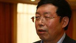 全国政协委员 周纪昌<br>国企是否垄断应由法律裁定