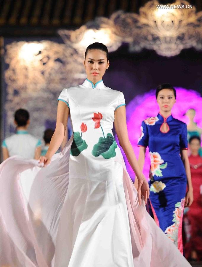 "Models present Asian costumes at the ""Oriental Night"" show on the sidelines of the Hue Festival in Vietnam"