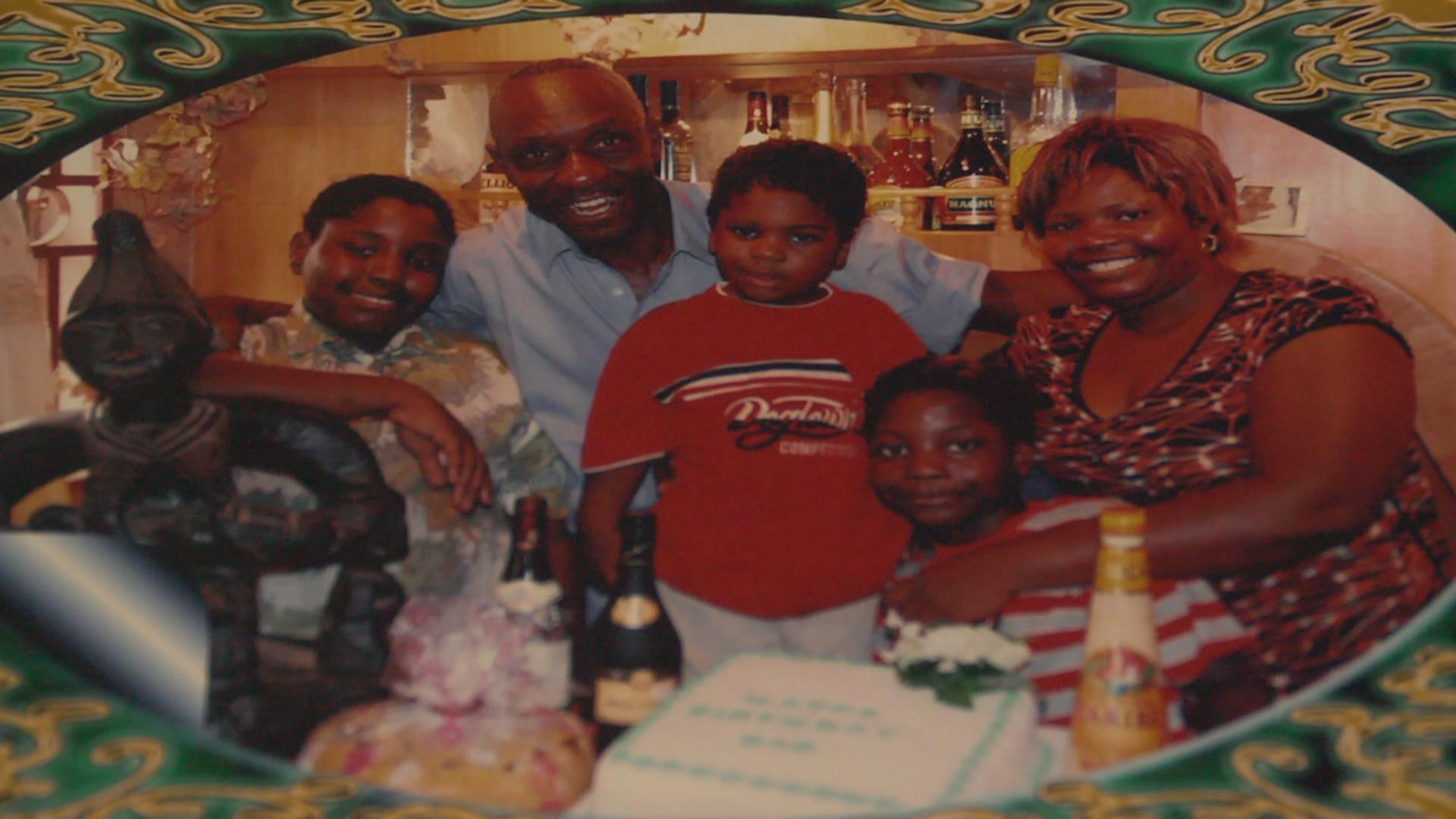 Pat Nebo,Nigerian with his family. He is one of the best art directors in Africa.