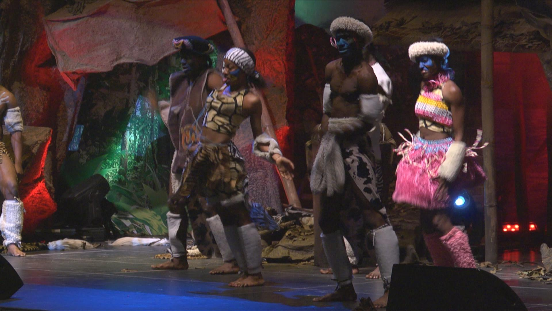 Performers on a stage that Pat and his crew made. The client wanted a jungle design.