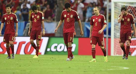Highly-spirited Chile stunned Spain 2-0 in their World Cup Group B second-round match here on Wednesday, sending the defending world champions packed and fixing a last-16 berth for themselves.