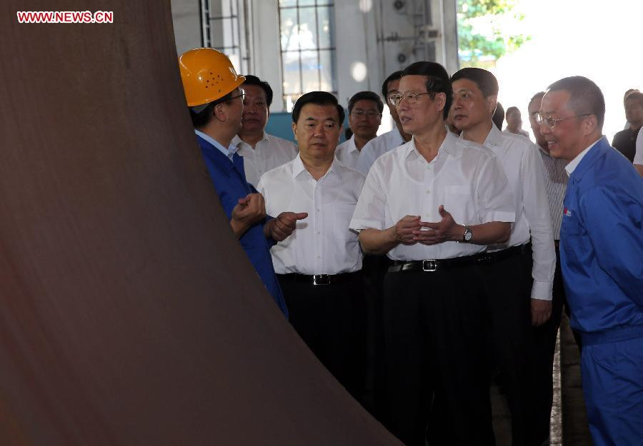 Chinese Vice Premier Zhang Gaoli (2nd R, front), also a member of the Standing Committee of the Political Bureau of the Communist Party of China Central Committee, visits Lanzhou Lanshi Group Co. Ltd. in Lanzhou, capital of northwest China
