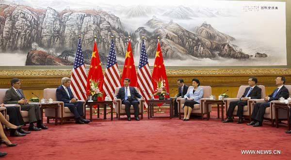 Chinese President Xi Jinping (3rd L) meets with U.S. Secretary of State John Kerry (2nd L) and Treasury Secretary Jacob Lew (1st L) in Beijing, capital of China, July 10, 2014. John Kerry and Jacob Lew came here to attend the Sixth Round of China-U.S. Strategic and Economic Dialogue and the Fifth Round of China-U.S. High-Level Consultation on People-to-People Exchange. (Xinhua/Huang Jingwen)
