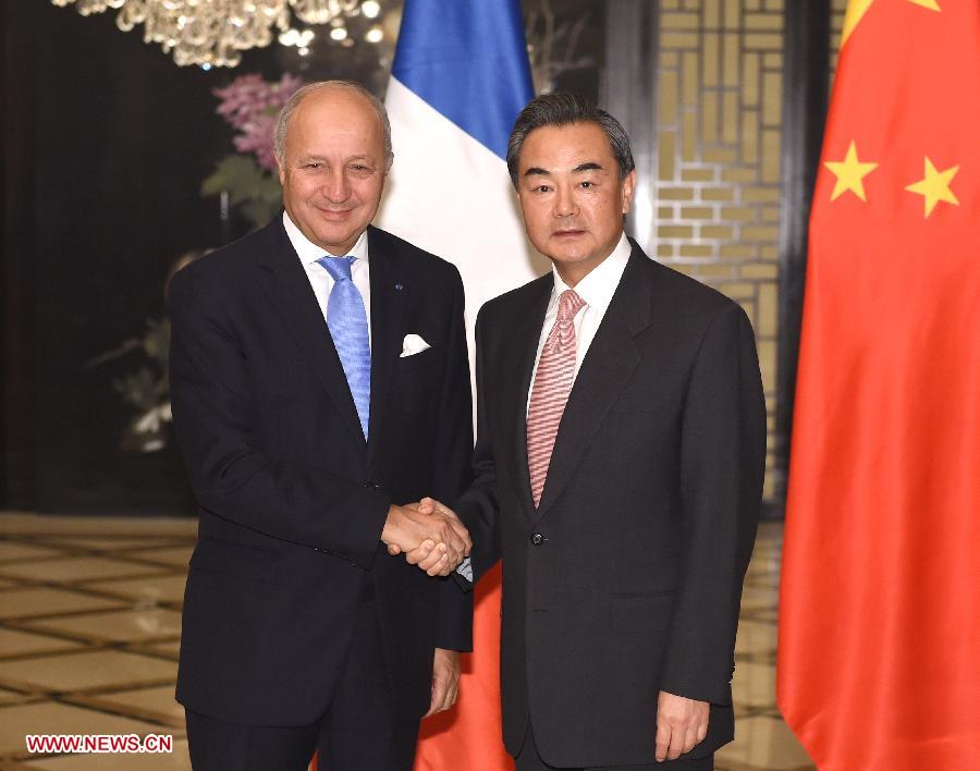 Chinese Foreign Minister Wang Yi (R) meets with French Foreign Minister Laurent Fabius in Beijing, capital of China, Oct. 19, 2014. (Xinhua/Ma Zhancheng)