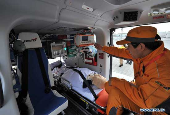 An air rescue team member shows devices of an ambulance helicopter of the Beijing Red Cross Foundation in Beijing, capital of China, Oct. 28, 2014. The ambulance helicopter, an EC135 aircraft equipped with aerial medical devices, will serve the professional air rescue team of the Beijing Red Cross Foundation. (Xinhua/Li Wen)