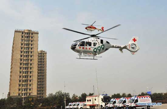 An ambulance helicopter of the Beijing Red Cross Foundation takes off in Beijing, capital of China, Oct. 28, 2014. The ambulance helicopter, an EC135 aircraft equipped with aerial medical devices, will serve the professional air rescue team of the Beijing Red Cross Foundation. (Xinhua/Li Wen)