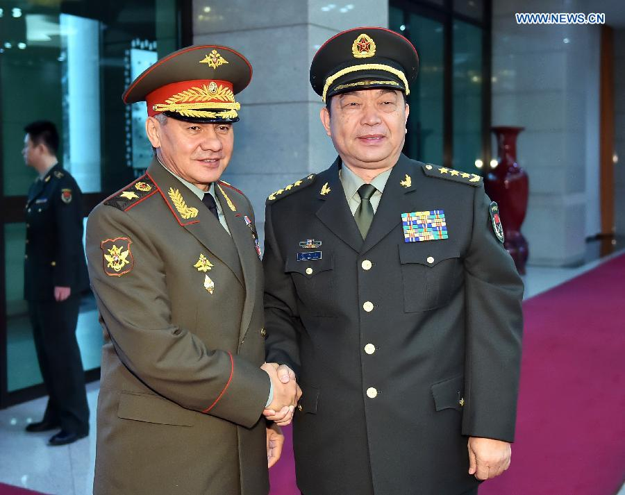 Chinese Defence Minister Chang Wanquan (R) meets with Russian Defence Minister Sergei Shoigu in Beijing, capital of China, Nov. 18, 2014. (Xinhua/Li Tao)