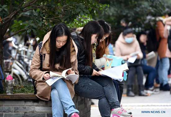 Candidates prepare for examination at Nanjing Forestry University exam site in Nanjing, capital of east China