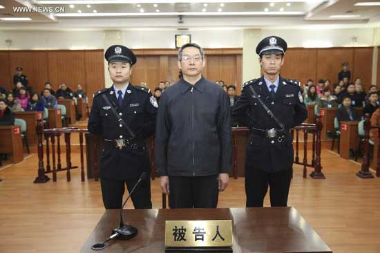 Liu Tienan (C), a former senior economic planning official, stands trial at the Langfang Intermediate People