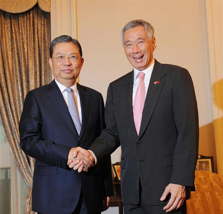 5月16日,新加坡总理李显龙在总统府会见中共中央政治局委员、中央书记处书记、中央组织部部长赵乐际。